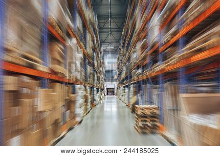 Large Logistics Hangar Warehouse With Lots Shelves Or Racks With Pallets Of Goods, Perspective With