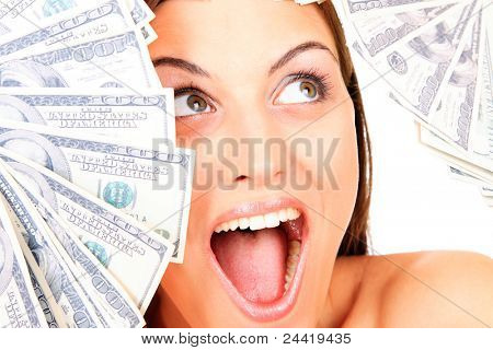 Young happy woman with dollar notes. Isolated on white background.