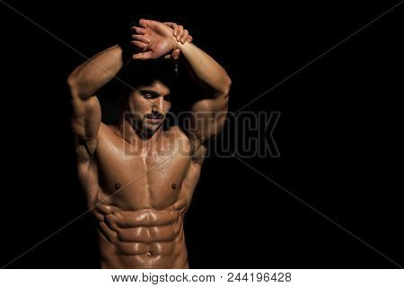 Sports Nutrition. Man With Muscular Body And Bare Chest Or Coach Sportsman In Jeans On Black Backgro