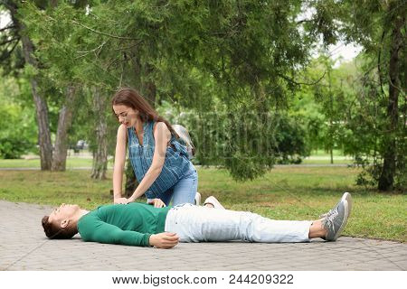 Passerby Performing Cpr On Man With Heart Attack Outdoors