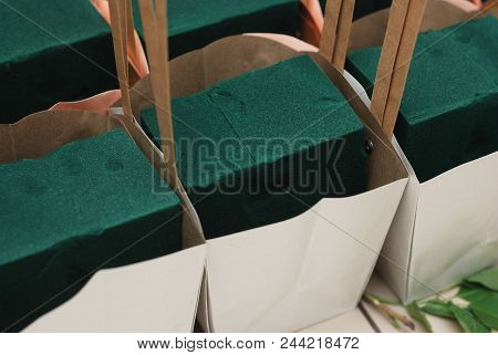 Florist Foam Equipment In Paper Baskets. Floristic Proces. Work Background Isoalted