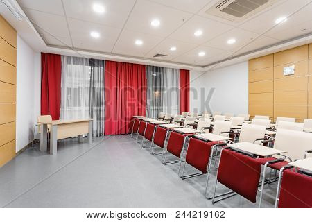 Seminar Presentation. Conference Room Full Of Empty Seats. Red Color. Auditorium For Workshops And S