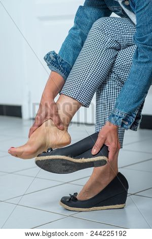A Massaging Tired Hurt Leg Due To Wearing  Shoes