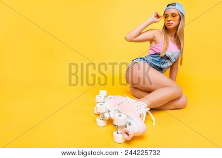 Portrait with copy space empty place of naughty sensual tender girl holding eyelet of glasses on face looking away having booty bum isolated on yellow background, workout fitness body care concept poster