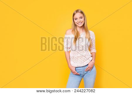 Portrait Of Charming Trendy Girl In Casual Outfit With Naked Shoulder Looking At Camera Holding Two