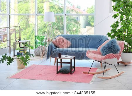 Elegant Living Room Interior With Rocking Chair And Cozy Sofa