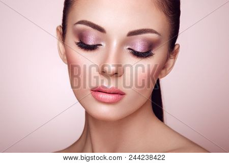 Beautiful Young Woman With Clean Fresh Skin. Perfect Makeup. Beauty Fashion. Eyelashes. Cosmetic Eye
