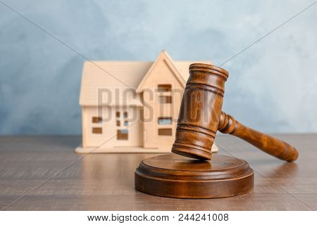 Judge Gavel And House Model On Table. Estate Law Concept