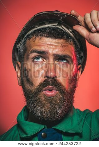 Builder In Protective Clothing And Helmet. Male Builder. Portrait Of Mechanical Worker. Portrait Of