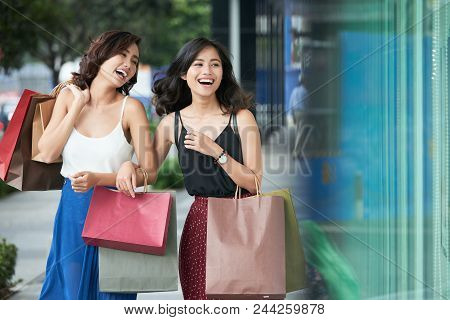 Happy Laughing Young Asian Women With Many Shopping Bags