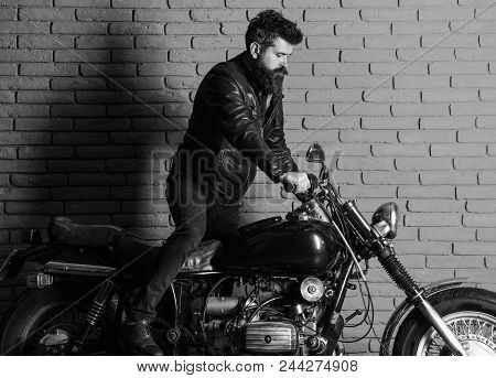 Man On A Motorcycle. Hipster, Brutal Biker On Serious Face In Leather Jacket Gets On Motorcycle. Man
