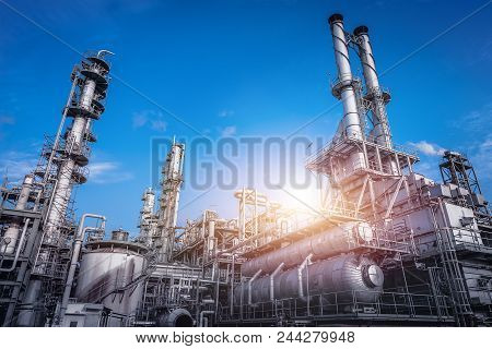 Industrial Furnace And Heat Exchanger Cracking Hydrocarbons In Factory On Blue Sky Background, Close