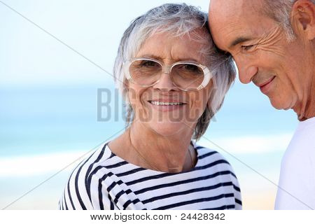 Elderly couple at the beach together