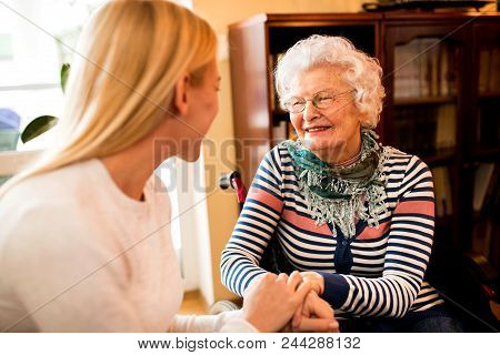Smiling Beautiful Senior Happy Woman With Her Daughter