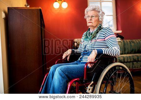 Forgotten By The Family, Sad Senior Woman At Wheelchair