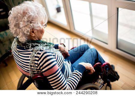 Sad Depression Loneliness Senior Woman In Wheelchair