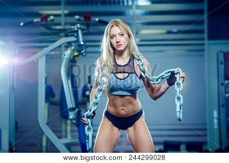 Young Sexy Woman Doing Exercises With Heavy Chain In Gym. Classic Bodybuilding. Muscular Blonde Fitn