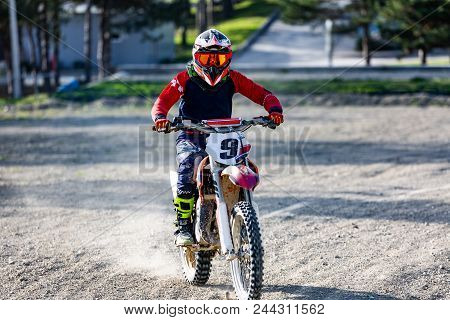 Professional Motocross Motorcycle Rider Drives Over The Dust Road Track.