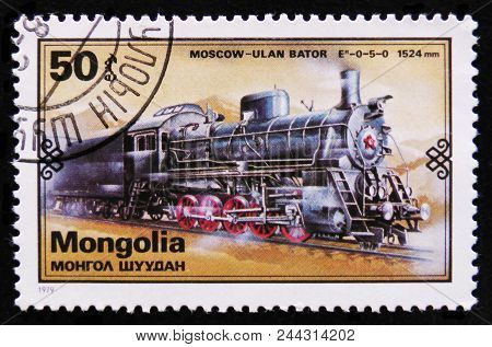 Moscow, Russia - April 2, 2017: A Post Stamp Printed In Mongolia Shows Moscow - Ulan Bator  Train, R