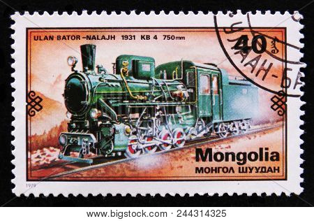 Moscow, Russia - April 2, 2017: A Post Stamp Printed In Mongolia Shows Ulan Bator-nalajh Train, 1931