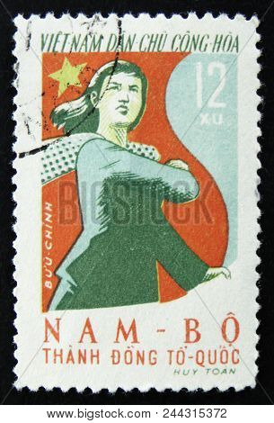 Moscow, Russia - April 2, 2017: A Postage Stamp Printed In Vietnam Shows Vietnamese Woman With Scarf
