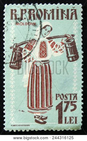 Moscow, Russia - April 2, 2017: A Post Stamp Printed In Romania Shows Woman In Regional Costume, Mol