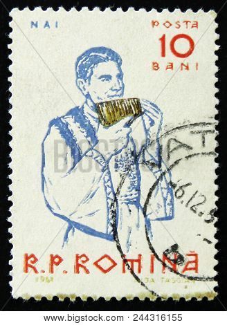 Moscow, Russia - April 2, 2017: A Post Stamp Printed In Romania Shows Peasants Playing Musical Instr