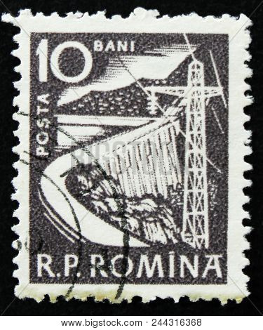 Moscow, Russia - April 2, 2017: A Post Stamp Printed In Romania Shows Dam And Electric Tower, Circa