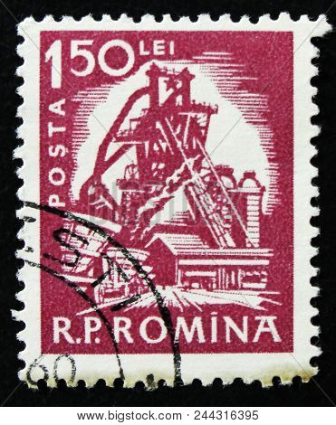 Moscow, Russia - April 2, 2017: A Post Stamp Printed In Romania Shows Iron-works Plant, Mine Economi