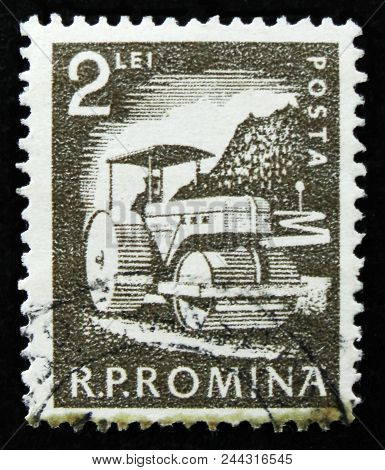 Moscow, Russia - April 2, 2017: A Post Stamp Printed In Romania Shows Lays Asphalt Compactor, Circa