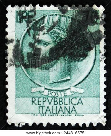Moscow, Russia - April 2, 2017: A Post Stamp Printed In Italy Shows Ancient Coin Of Syracuse, The Se