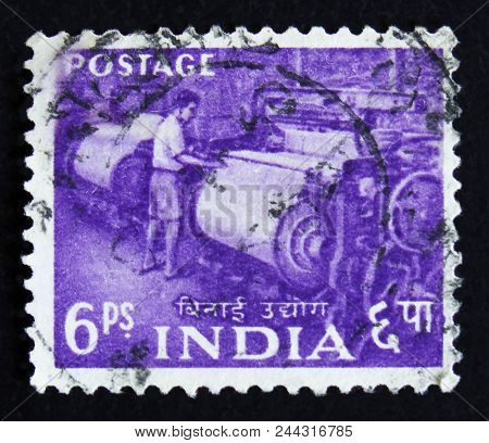 Moscow, Russia - April 2, 2017: A Post Stamp Printed In India Shows Man Working A Weaving Loom, Seri
