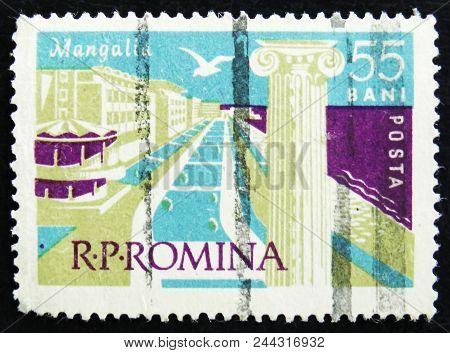 Moscow, Russia - April 2, 2017: A Post Stamp Printed In Romania Shows Mangalia Beach, Black Sea Reso
