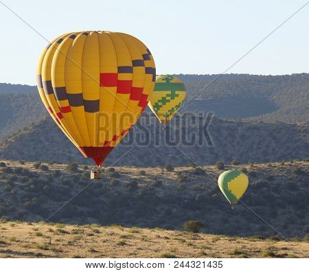 A Trio Of Hot Air Balloons Races Near Sedona, Arizona