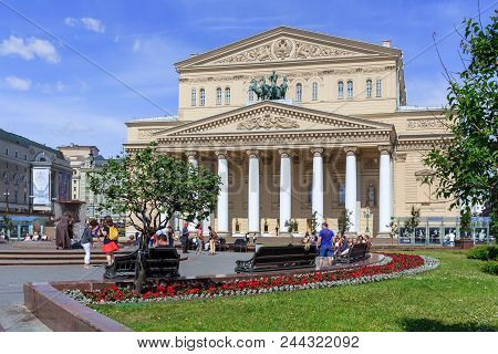 Moscow, Russia - June 03, 2018: Walking Tourists On Theatre Square Near Building Of Bolshoi Theatre