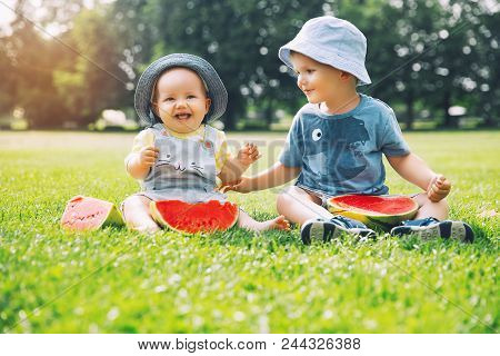Funny Children Eating Watermelon On Nature At Summer