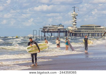 Scheveningen, The Netherlands - August 10 2013: Group Of Young People With Surf Boards On Schevening
