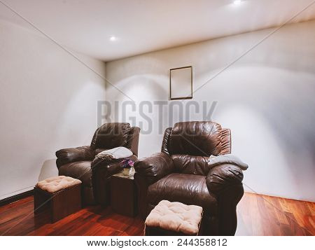 Two Black Leather Comfortable Chairs In Spa And Massage Room