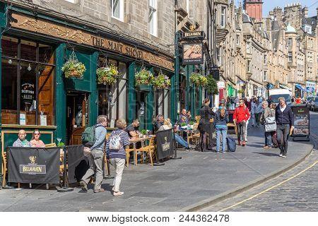 Edinburgh, Scotland - May 24, 2018: Pub Near Waverley Station And The Royal Mile With People Sitting