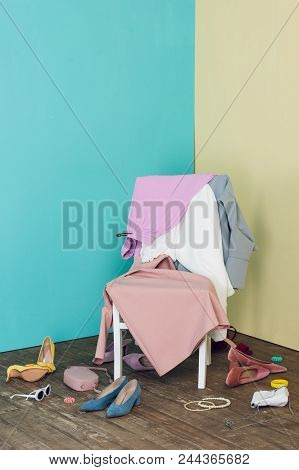 Messy Room With Elegant Clothes And Shoes On Chair