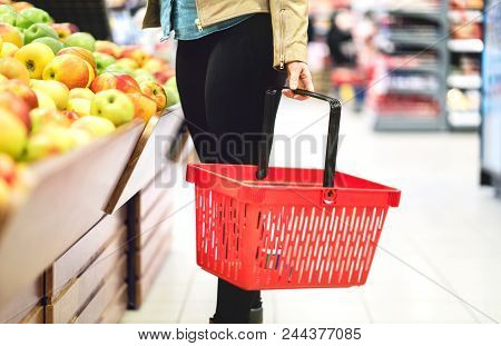 Retail, Sale And Consumerism Concept. Customer In Supermarket Vegetable And Fruit Section Choosing H