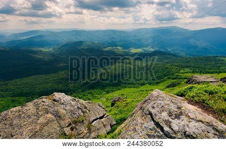 Rocks On The Edge Of A  Mountain. Location Pikui Mountain. Runa Mountain In The Far Distance. Beauti