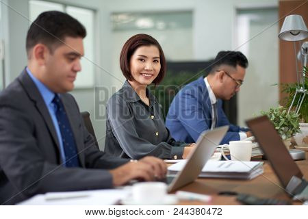 Multi-ethnic Group Of Financial Managers Gathered Together At Spacious Boardroom And Finishing Annua