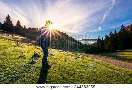 Photographer In Sunburst Shooting Foggy Landscape. Gorgeous Scenery Of Apuseni Natural Park In Autum