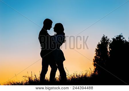 Love Concept. Silhouette Of Couple.silhouette Of A Loving Couple On The Background Of The Setting Su