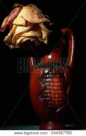 Faded Rose In Amphora. Concept Of Sadness And Loneliness