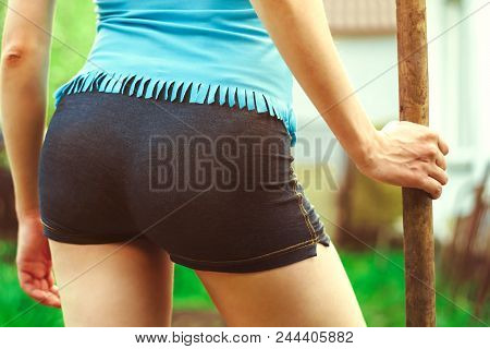 A Woman With A Shovel In Short Shorts Booty Close Up