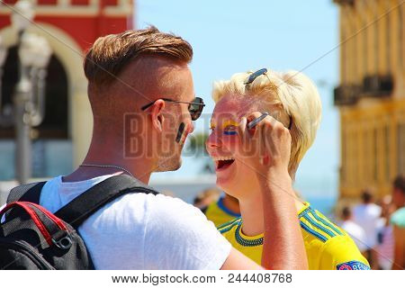 Nice, France - June 22, 2016: Football Fans Painting Faces At The Day Of Uefa Euro 2016 Game Belgium