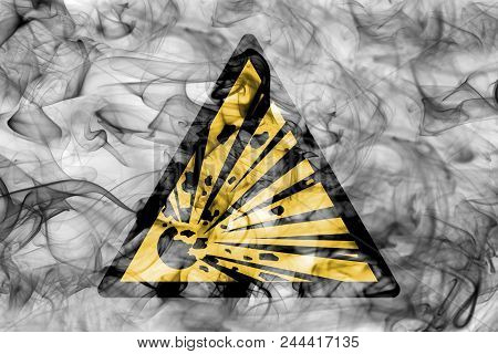 Explosive Substances Hazard Warning Smoke Sign. Triangular Warning Hazard Sign, Smoke Background.