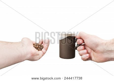 Male Hands Holding A Cup Of Coffee In One Hand And A Handful Of Coffee Beans In Another, Isolated On